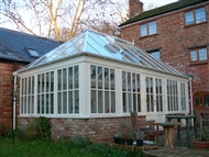 Hardwood Conservatory glass hip roof with georgean windows